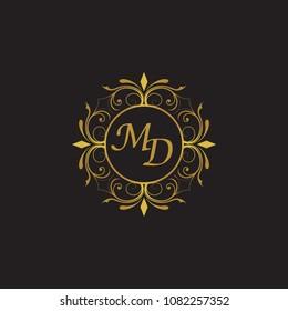 MD Initial logo. Ornament ampersand monogram golden logo black background