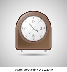 Mechanical table clock on a gray background