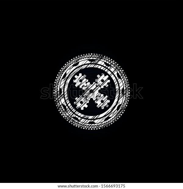 mechanism icon inside chalkboard emblem written on a blackboard