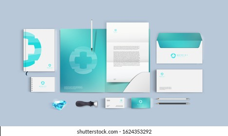Medical brand template in blue and cyan colors. Corporate identity mockup for clinic or pharmacy. Realistic style for presentation busines and company. Top view vector format. Premium stationery set.