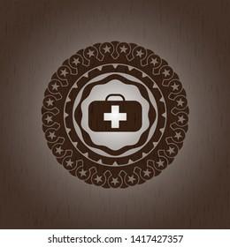 medical briefcase icon inside realistic wood emblem