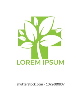 Medical cross and green leafs vector logo concept illustration. Natural Health Care Logo, Natural Treatment Logo.