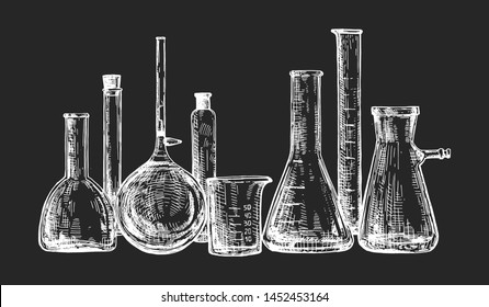 Medical laboratory test tubes and bulbs flask. Professional science chemistry lab equipment glassware for the experiments and examinations. On black board chalk hand drawing.