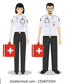 Medical teamwork concept. Detailed illustration сouple of paramedic man and woman, emergency doctor, nurse in flat style on white background. Practitioner doctors standing together. Vector