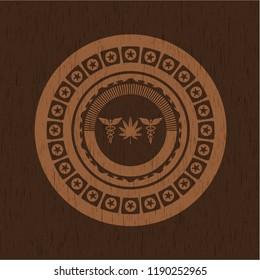 medicinal weed icon inside vintage wooden emblem