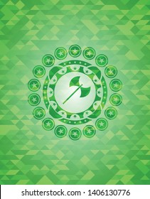 medieval axe icon inside green mosaic emblem