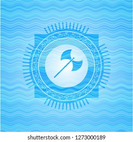 medieval axe icon inside water wave concept badge background.