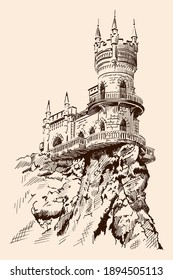 Medieval stone castle with towers and arches on a rocky cliff.