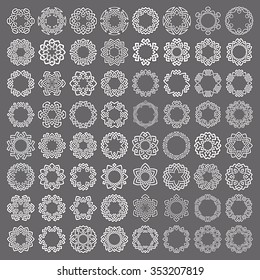 Mega set of round frames. Sixty four patterned circles. Hexagonal decorative elements for logo or monogram design. Mandalas collection of white lines with black strokes on gray background.