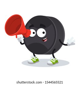 With megaphone cartoon black rubber hockey puck character mascot on white background