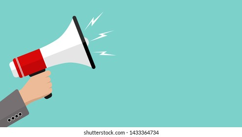 Megaphone on a green background with copy space, business marketing, promotion and advertising.