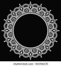Mehndi, Indian Henna tattoo round white pattern on black