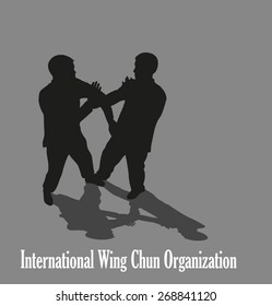 Men are engaged in the Kung fu Wing Chun.