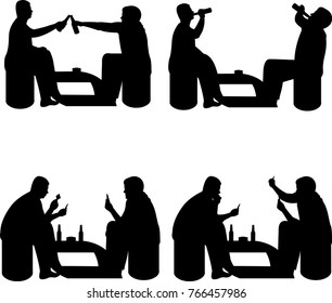 Men playing cards and drinking beer for fun silhouette