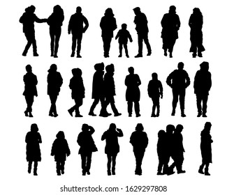 Men and women in winter clothes are walking along street. Isolated silhouettes of people on a white background
