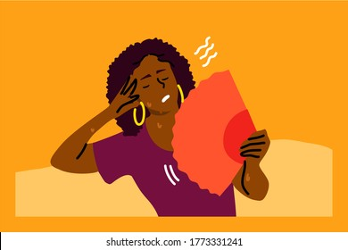 Mental stress, heat, dehydration, inconvenience concept. Stressed exhaustion annoyed young woman sitting on sofa using waving fan suffering from overheating in summer. Absence air conditioner at home.