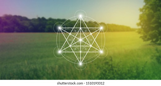 Merkaba sacred geometry spiritual new age futuristic illustration with interlocking circles, triangles and glowing particles in front of blurry natural widescreen photographic background