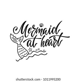 Mermaid at heart. Inspirational quote about summer. Modern calligraphy phrase with hand drawn mermaid's tail. Simple vector lettering for print and poster. Typography design.