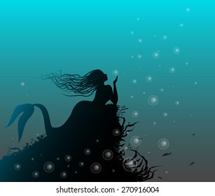 mermaid laying on the rock and playing with bubbles, sea fairytale, silhouette