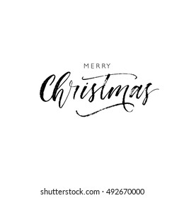 Merry Christmas card. Hand drawn greeting phrase. Ink illustration. Modern brush calligraphy. Isolated on white background.