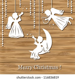 Merry Christmas Greeting Card with Angels on a wood background