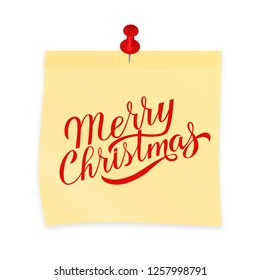 Merry Christmas hand written on yellow sticky note attached with red pin. Realistic sticker and pushpin isolated on white. Holidays vector illustration. Easy to edit template for your design projects.
