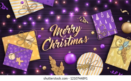 Merry Christmas and happy new year. Beautiful background with Christmas decoration: purple and gold balls, craft gift boxes and garlands on wooden backdrop. Xmas holiday greeting card, festive poster