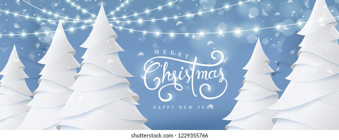 Merry Christmas and Happy New Year background for Greeting cards with christmas tree landscape growing lights and snowing paper art style.Calligraphy of christmas.Vector illustration.