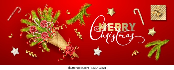 Merry Christmas and Happy New Year bouquet in a waffle cone of coniferous branches. Festive Christmas tree decorations on red background