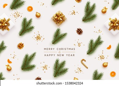 Merry Christmas and Happy New Year. Xmas background with realistic festive decorative design elements. Pine and spruce branches, gift box, pine cone, orange, ball bauble. Flat lay, top view.