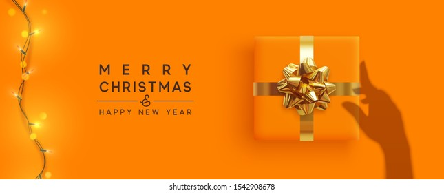 Merry Christmas and Happy New Year. Background with realistic gift box, bright christmas lights garland. Silhouette shadow from the hands holds Xmas presents. Creative getting card, holiday banner.