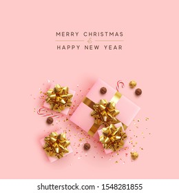 Merry Christmas. Happy New Year. Realistic pink gift boxes, glitter gold confetti, Chocolate round candy in foil, sweet cane. Xmas present. flat lay, top view. Festive background. Vector illustration