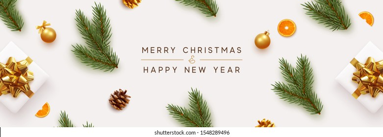 Merry Christmas and Happy New Year banner. Xmas background with realistic festive decorative design elements. Pine and spruce branches, gift box, pine cone, orange, ball bauble. Flat lay, top view.