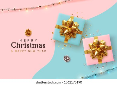 Merry Christmas and Happy New Year. Xmas background with realistic pink and blue gift boxes, festive bright light garland, Holiday banner, poster, greeting card. Advertising flyer brochure. soft color