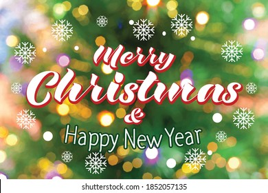 Merry Christmas and Happy New Year lettering over christmas tree background