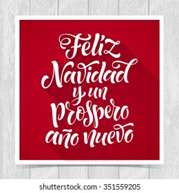 Merry Christmas and Happy New Year text in Spanish: Feliz Navidad y un Prospero Ano Nuevo. Vector lettering for invitation, greeting card, prints. Hand drawn inscription, calligraphic holidays design