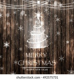 Merry Christmas and Happy new year. Christmas shiny tree with snowflakes, garland on the wooden table. Design template for flyer, banner, invitation, congratulation, poster design. Vector illustration