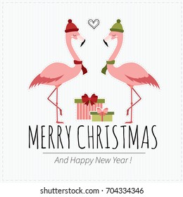 Merry Christmas and  happy New Year. Cute holiday card with  flamingos and gift boxes