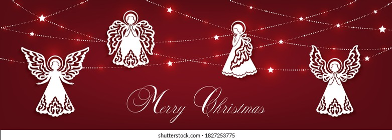 Merry Christmas horizontal greeting card. White angels, garland with shine stars isolated on a red backdrop.