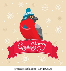 Merry Christmas postcard. Bullfinch bird wearing warm cap sitting on the ribbon. Hand-drawn words Merry Christmas lettering. Snowflakes on the background.  Vector illustration.
