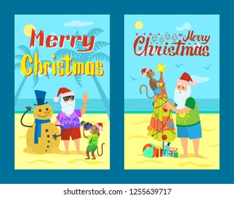 Merry Christmas, Santa Claus making photo with snowman made of sand. Monkey and Saint Nicholas decorating umbrella as abstract New Year tree, summer holidays