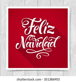 Merry Christmas text in Spanish: Feliz Navidad. Vector lettering for invitation, greeting card, prints. Hand drawn inscription, calligraphic holidays design