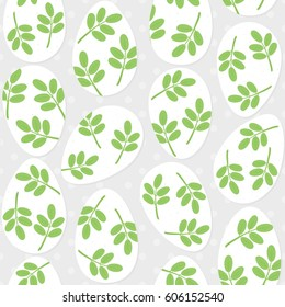 messy white eggs with green leaf motif, vector Easter seamless pattern on light dotted background