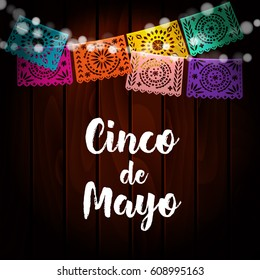 Mexican Cinco de Mayo greeting card, invitation. Party decoration, string of lights, handmade cut paper flags. Old wooden background. Vector illustration.