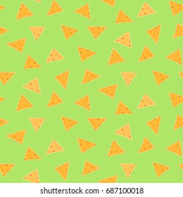 Mexican fast food seamless pattern with nachos on green guacamole background. Nice spanish fastfood texture for textile, wallpaper, background, cover, banner, bar and cafe menu design.