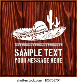 Mexican sombrero with cactus and text on wooden background