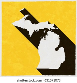 Michigan map on retro poster with long shadow. Vintage sign with grunge effects. Vector illustration, easy to edit, manipulate, resize or colorize.