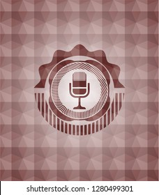 microphone icon inside red geometric pattern emblem. Seamless.