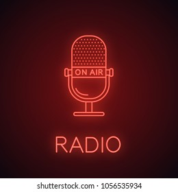 Microphone neon light icon. Radio broadcasting. On air glowing sign. Vector isolated illustration