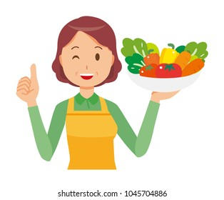 A middle-aged housewife wearing an apron has vegetables